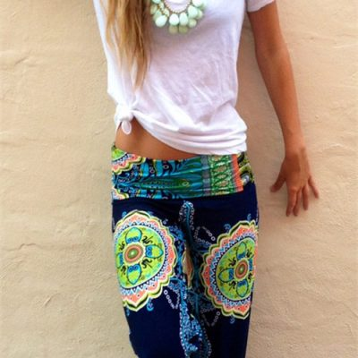 girl wears floral harem trousers