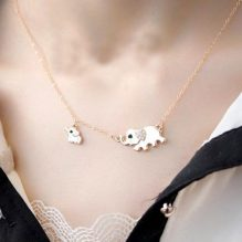 elephant family necklace worn cover image
