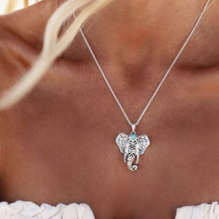 Turquoise Elephant ganesha Necklace worn by a woman cover image