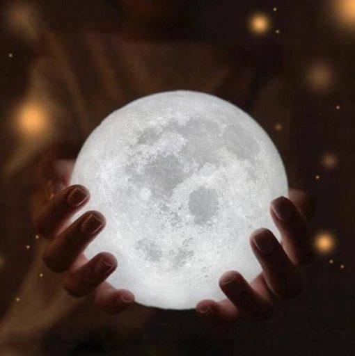 moon lamp in hands