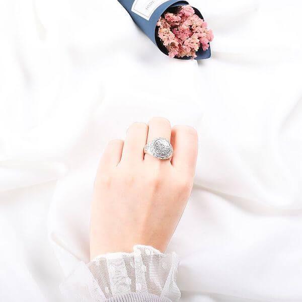 hand-wearing-om-mani-padme-hum-lotus-ring